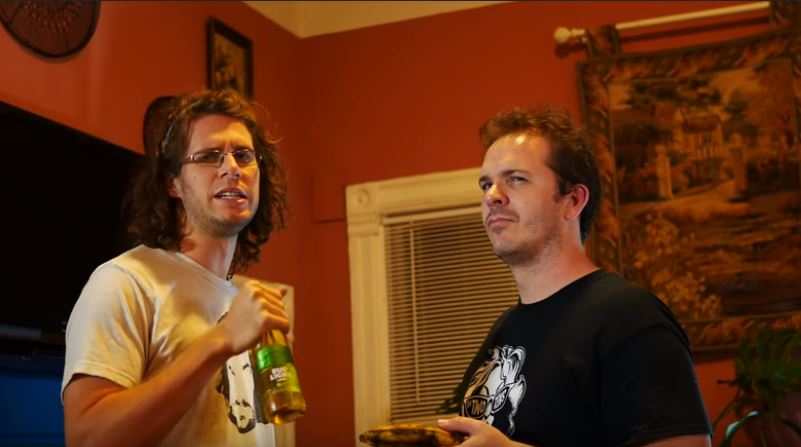 Two guys at a party in a nicely decorated living room, one holding an old banana and the other holding a bud light lime, off screen he is letting a pirate man with hooks for hands that he believes the pirate is addicted to weed.