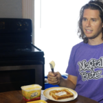 Guy Buttering his toast with I can't believe it's not butter while wearing a shirt for Magicalbutter.com