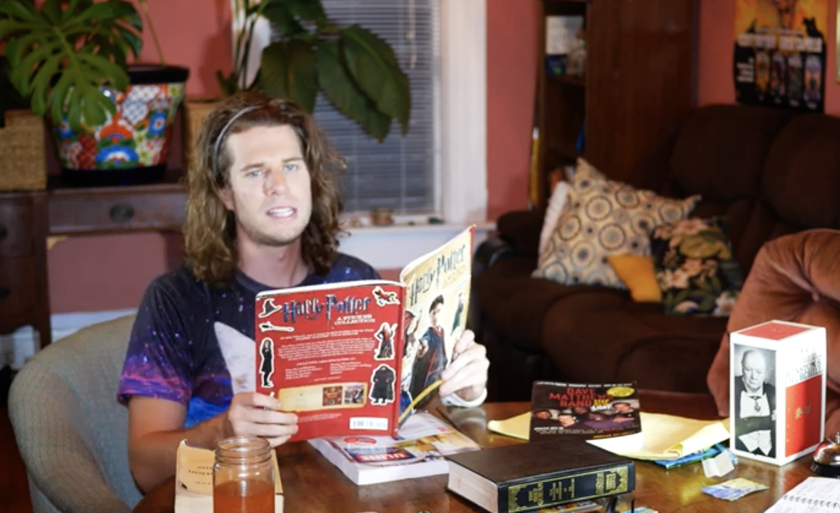 Guy reading Harry Potter sticker book can't go out because he has to suit up and hit the books
