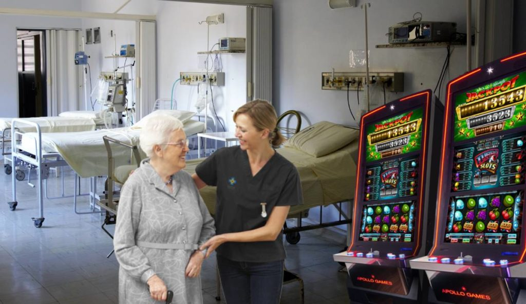 Nurse helps older lady to the slot machines in her hospital room